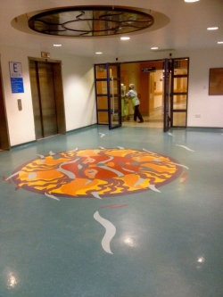 Leeds General Infirmary, Jubilee Building E Floor, Lift-Lobby stained glass light and floor – sun reflected in a pool